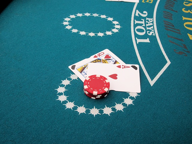 Queen, Ace and Casino Chips on Blackjack table.